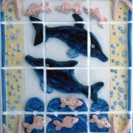 Dolphins and fish tile panel